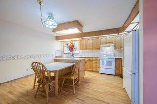 Photo 7: 85 Edgeland Road NW in Calgary: Edgemont Row/Townhouse for sale : MLS®# A1103490