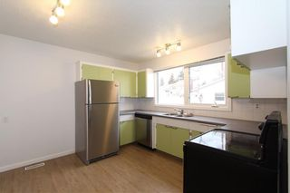 Photo 9: 1112 NINGA Road NW in Calgary: North Haven Semi Detached for sale : MLS®# C4222139