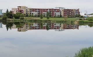 Photo 1: 2231 604 East Lake Boulevard NE: Airdrie Apartment for sale : MLS®# A1045955
