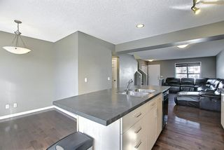 Photo 10: 3326 New Brighton Gardens SE in Calgary: New Brighton Row/Townhouse for sale : MLS®# A1077615