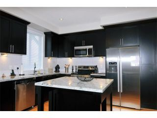 """Photo 2: 115 1460 SOUTHVIEW Street in Coquitlam: Burke Mountain Townhouse for sale in """"CEDAR CREEK"""" : MLS®# V984770"""
