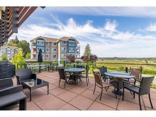 """Photo 30: 104 16398 64 Avenue in Surrey: Cloverdale BC Condo for sale in """"The Ridge at Bose Farm"""" (Cloverdale)  : MLS®# R2590975"""