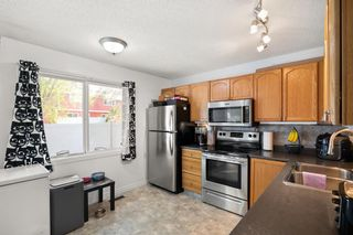 Photo 7: 14 Queen Anne Close SE in Calgary: Queensland Row/Townhouse for sale : MLS®# A1146388