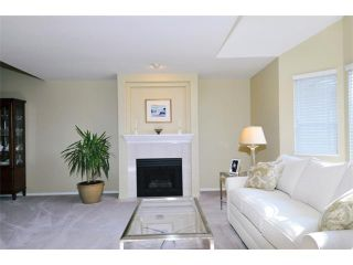 """Photo 2: 149 101 PARKSIDE Drive in Port Moody: Heritage Mountain Townhouse for sale in """"TREETOPS"""" : MLS®# V994969"""