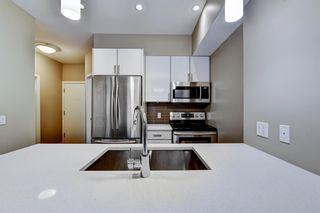 Photo 7: 211 28 Auburn Bay Link SE in Calgary: Auburn Bay Apartment for sale : MLS®# A1076356