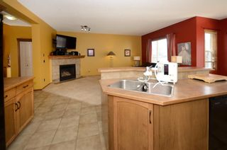 Photo 10: 48 Cranfield Manor SE in Calgary: Cranston Detached for sale : MLS®# A1153588
