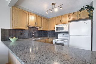 Photo 3: 104 Millview Green SW in Calgary: Millrise Row/Townhouse for sale : MLS®# A1120557