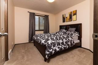 Photo 13: 30 WEST POINTE Manor: Cochrane House for sale : MLS®# C4150247