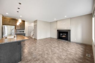 Photo 4: 76 Brightoncrest Rise SE in Calgary: New Brighton Detached for sale : MLS®# A1153438