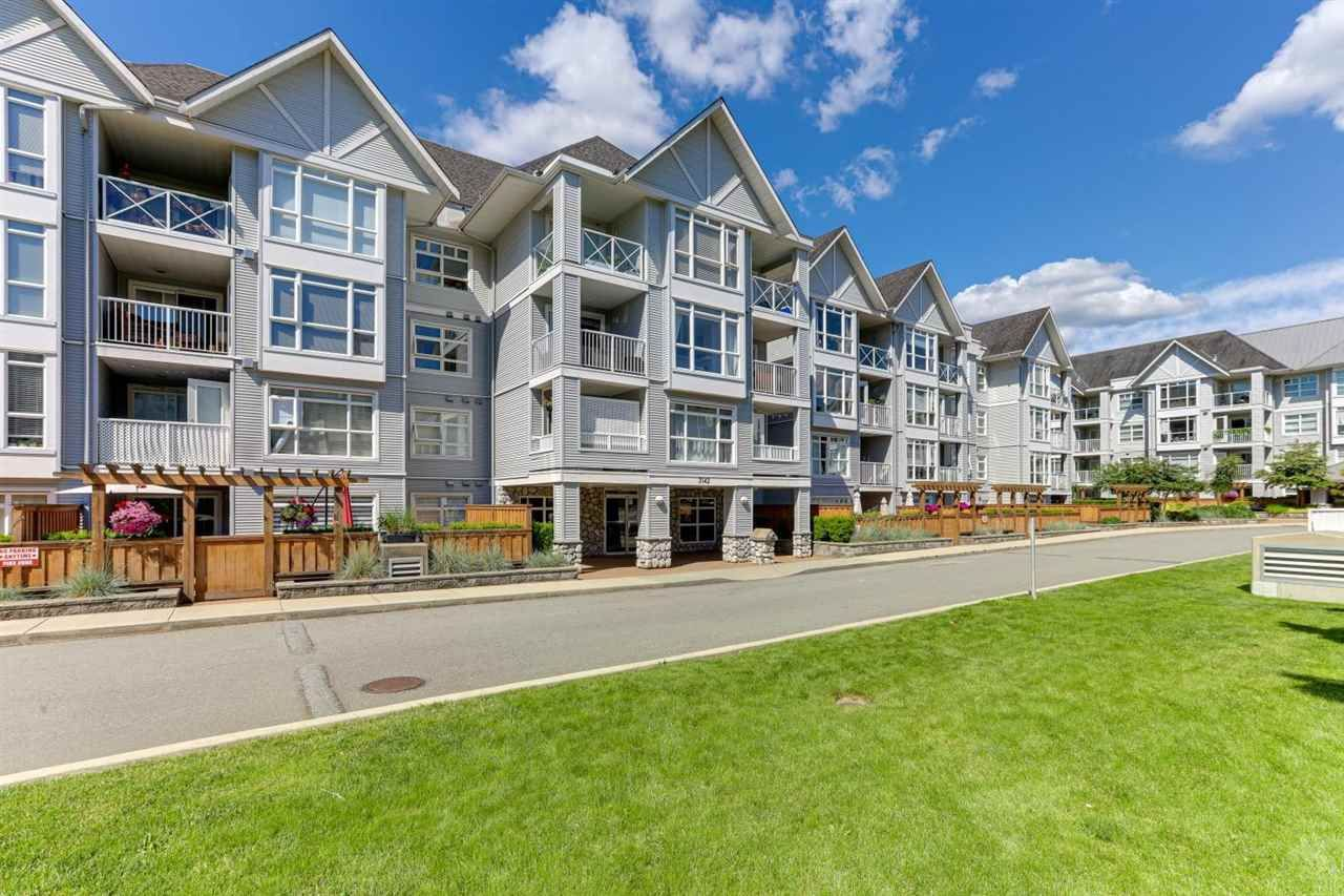 """Main Photo: 213 3142 ST JOHNS Street in Port Moody: Port Moody Centre Condo for sale in """"SONRISA"""" : MLS®# R2590870"""