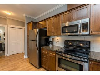 """Photo 6: 401 33338 MAYFAIR Avenue in Abbotsford: Central Abbotsford Condo for sale in """"THE STERLING"""" : MLS®# R2617623"""