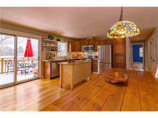 Photo 5: 14 GLENWOOD Court: Cochrane House for sale : MLS®# C4110479