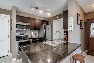 Photo 3: 6207 403 MACKENZIE Way SW: Airdrie Apartment for sale : MLS®# A1037130