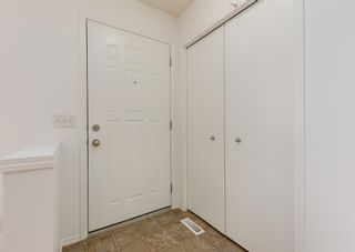Photo 3: 311 Toscana Gardens NW in Calgary: Tuscany Row/Townhouse for sale : MLS®# A1133126