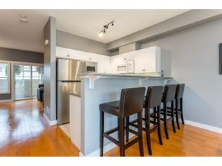 """Photo 2: 17 18707 65 Avenue in Surrey: Cloverdale BC Townhouse for sale in """"Legends"""" (Cloverdale)  : MLS®# R2616844"""