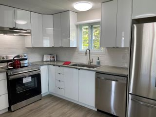 """Photo 2: 119 1840 160 Street in Surrey: King George Corridor Manufactured Home for sale in """"Breakaway Bays"""" (South Surrey White Rock)  : MLS®# R2598312"""