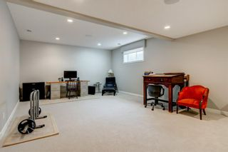 Photo 35: 707 Shawnee Drive SW in Calgary: Shawnee Slopes Detached for sale : MLS®# A1109379