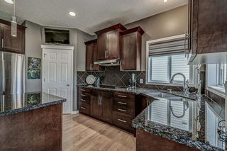 Photo 8: 66 Everhollow Rise SW in Calgary: Evergreen Detached for sale : MLS®# A1101731