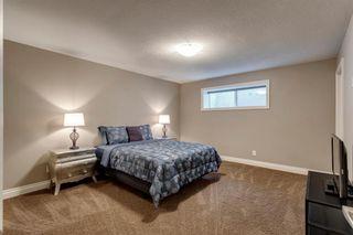 Photo 30: 212 QUARRY PARK Boulevard SE in Calgary: Douglasdale/Glen Row/Townhouse for sale : MLS®# A1095917