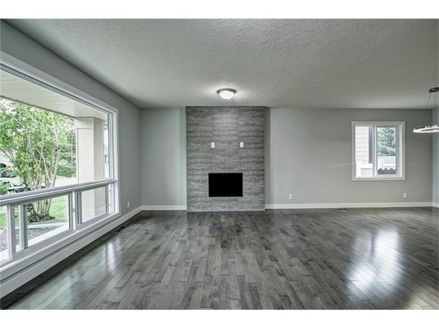 Photo 5: Photos: 448 CEDARPARK Drive SW in Calgary: Cedarbrae House for sale : MLS®# C4084629