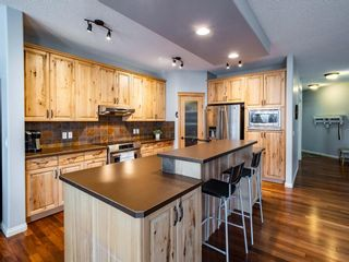 Photo 7: 878 Auburn Bay Boulevard SE in Calgary: Auburn Bay Detached for sale : MLS®# A1077618