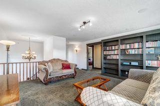 Photo 28: 102 Ridge View Place: Cochrane Detached for sale : MLS®# A1147672