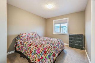 Photo 24: 70 West Pointe MR: Cochrane House for sale : MLS®# C4147028