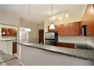 Photo 4: 315 100 CAPILANO Road in Port Moody: Port Moody Centre Condo for sale : MLS®# V985603
