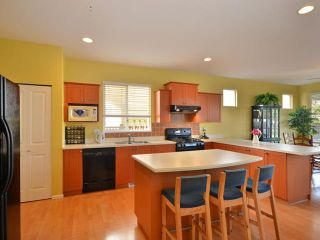 """Photo 3: 1081 TIGRIS Crescent in Port Coquitlam: Riverwood House for sale in """"N"""" : MLS®# V932935"""