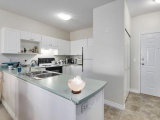 """Photo 7: 207 2109 ROWLAND Street in Port Coquitlam: Central Pt Coquitlam Condo for sale in """"PARKVIEW PLACE"""" : MLS®# R2542754"""