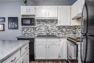 Photo 6: 139 Mt Douglas Manor SE in Calgary: McKenzie Lake Row/Townhouse for sale : MLS®# A1149851