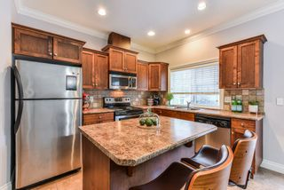 """Photo 8: 54 6498 SOUTHDOWNE Place in Sardis: Sardis East Vedder Rd Townhouse for sale in """"VILLAGE GREEN"""" : MLS®# R2340910"""