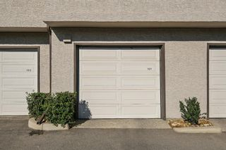 Photo 15: 101 1997 Sirocco Drive SW in Calgary: Signal Hill Row/Townhouse for sale : MLS®# A1142333