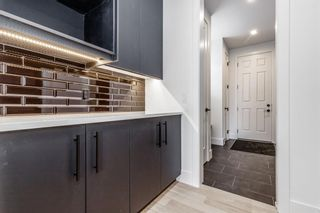 Photo 14: 7853 8A Avenue SW in Calgary: West Springs Detached for sale : MLS®# A1136445