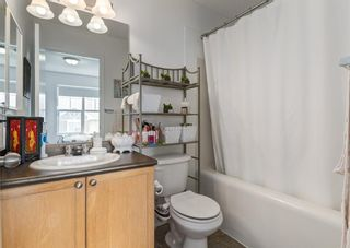Photo 17: 311 Toscana Gardens NW in Calgary: Tuscany Row/Townhouse for sale : MLS®# A1118245