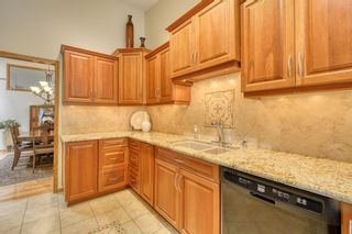 Photo 21: 20A Woodmeadow Close SW in Calgary: Woodlands Row/Townhouse for sale : MLS®# A1127050