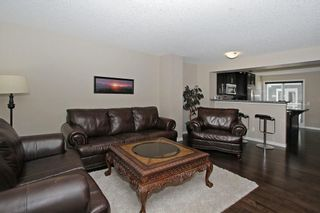 Photo 8: 105 AUBURN BAY Square SE in Calgary: Auburn Bay Row/Townhouse for sale : MLS®# C4278130