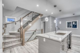 Photo 4: 4302 Bowness Road NW in Calgary: Montgomery Row/Townhouse for sale : MLS®# A1148589