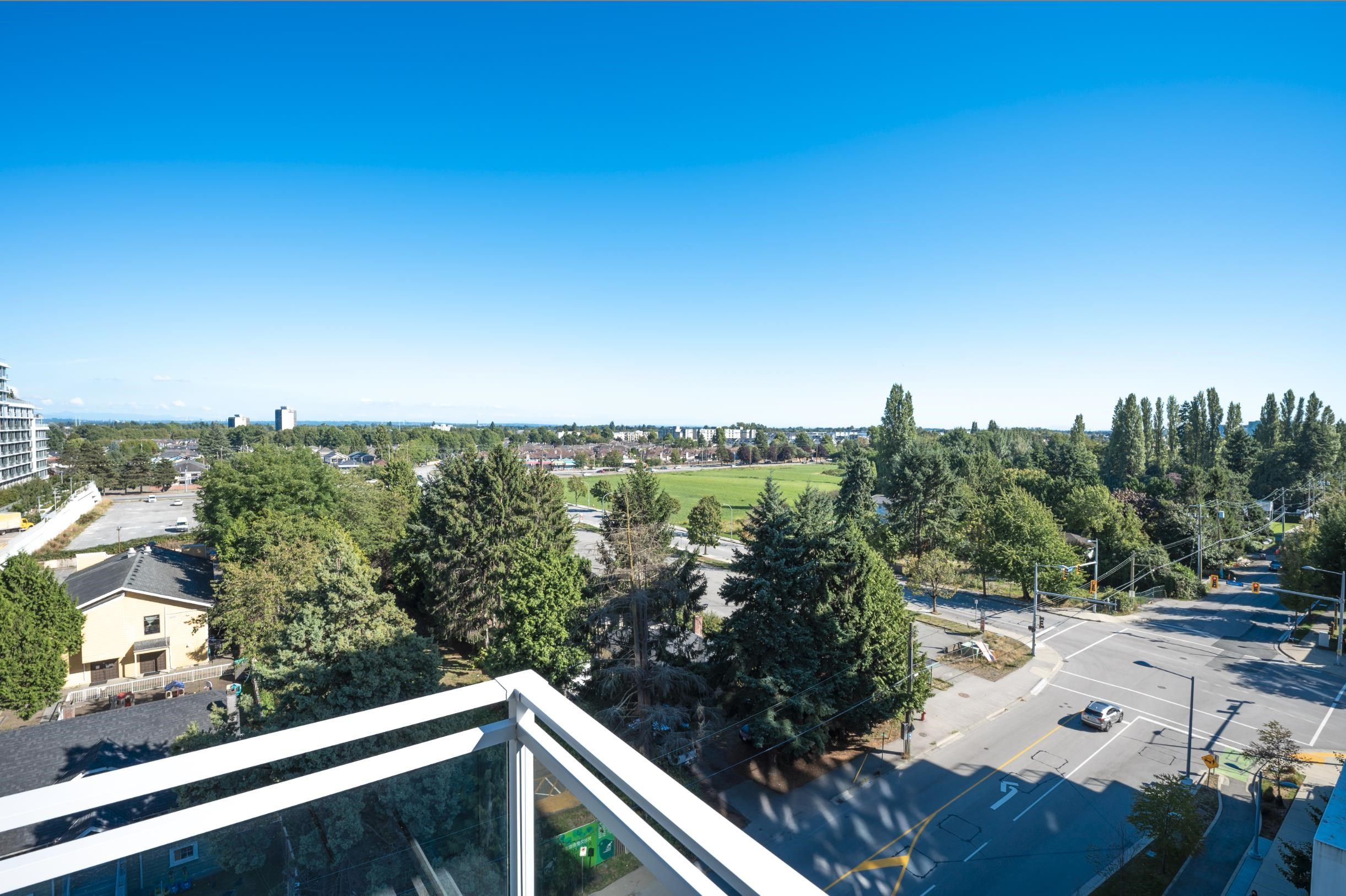 Main Photo: 911 3333 SEXSMITH Road in Richmond: West Cambie Condo for sale : MLS®# R2615103
