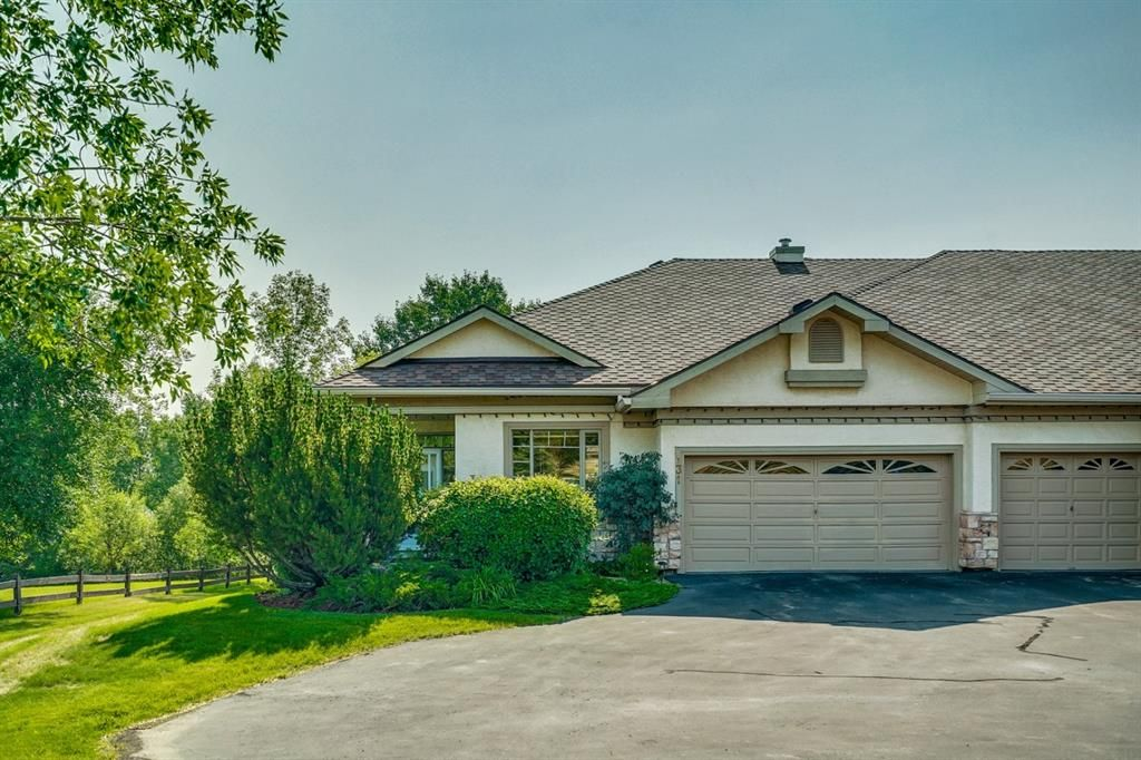 Main Photo: 131 Country Club in Rural Rocky View County: Rural Rocky View MD Semi Detached for sale : MLS®# A1115761