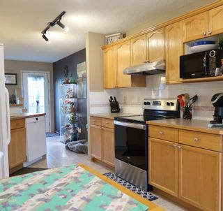 Photo 5: 85 Hidden Ranch Hill NW in Calgary: Hidden Valley Detached for sale : MLS®# A1100795