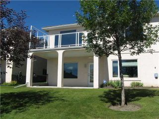 Photo 2: 46 EAGLEVIEW Heights in RED DEER: Cochrane Residential Attached for sale : MLS®# C3442597
