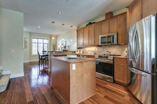 Photo 4: 17 11 Scarpe Drive SW in Calgary: Garrison Woods Row/Townhouse for sale : MLS®# A1103969