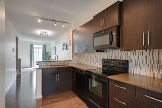 Photo 13: 111 Ascot Point SW in Calgary: Aspen Woods Row/Townhouse for sale : MLS®# A1144877