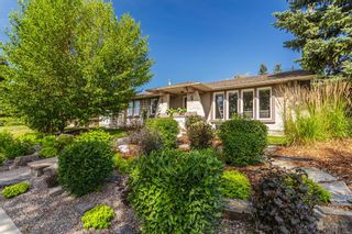 Photo 1: 243 Parkwood Close SE in Calgary: Parkland Detached for sale : MLS®# A1134335