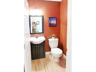 Photo 6: 772 LUXSTONE Landing SW: Airdrie House for sale : MLS®# C4016201