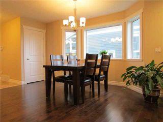 """Photo 5: 10420 109TH Street in Fort St. John: Fort St. John - City NW 1/2 Duplex for sale in """"SUNSET RIDGE"""" (Fort St. John (Zone 60))  : MLS®# N231276"""