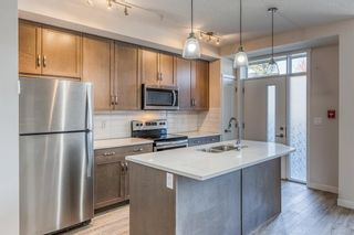 Photo 3: 12 30 Shawnee Common SW in Calgary: Shawnee Slopes Apartment for sale : MLS®# A1106401