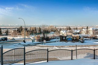 Photo 4: 219 Rocky Vista Circle NW in Calgary: Rocky Ridge Row/Townhouse for sale : MLS®# A1074376