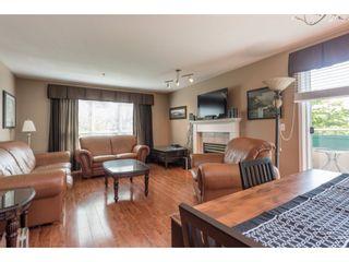 "Photo 1: 313 13860 70 Avenue in Surrey: East Newton Condo for sale in ""CHELSEA GARDENS"" : MLS®# R2175558"